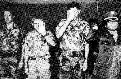 British military advisors embarrassed to be photographed at a passing out ceremony of an elite Colombian army unit, 1995. After Amnesty International