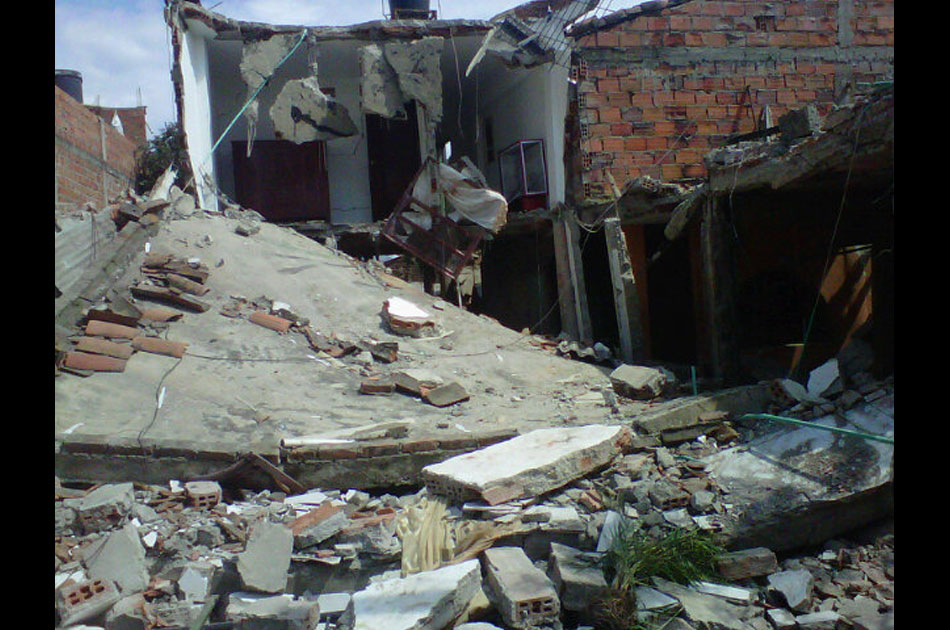 destruction of buildings and homes near police station